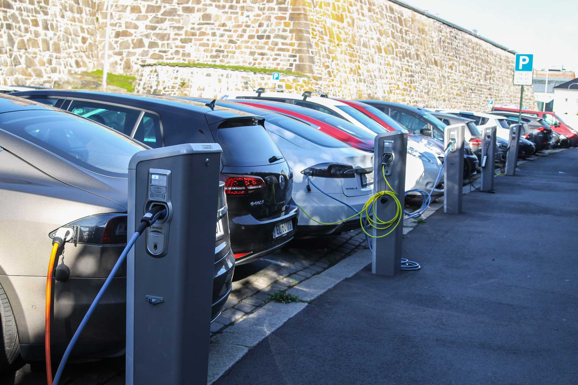 Electric cars plugged in and charging in Oslo, Norway