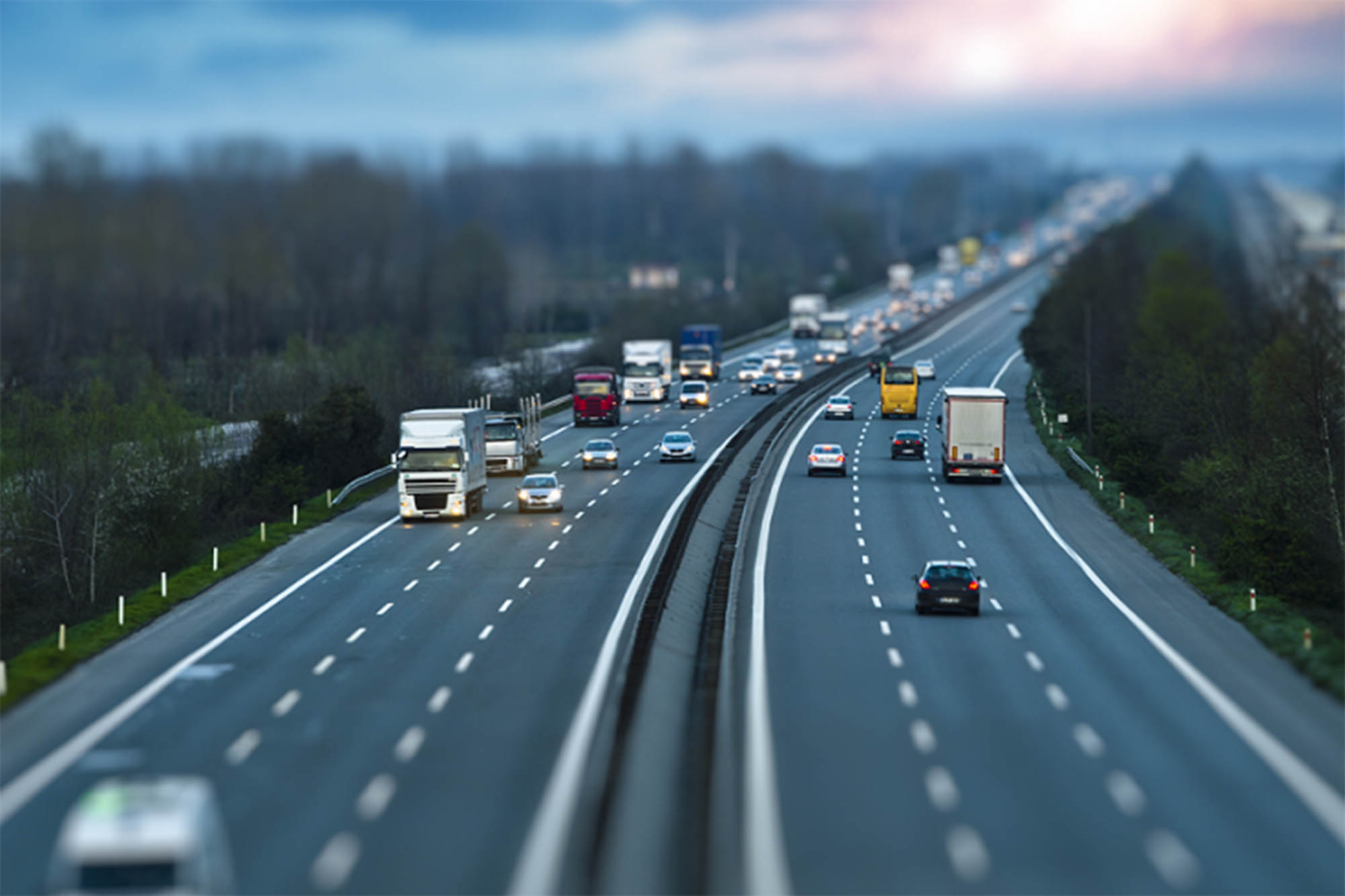 cars and trucks on a six lane highway