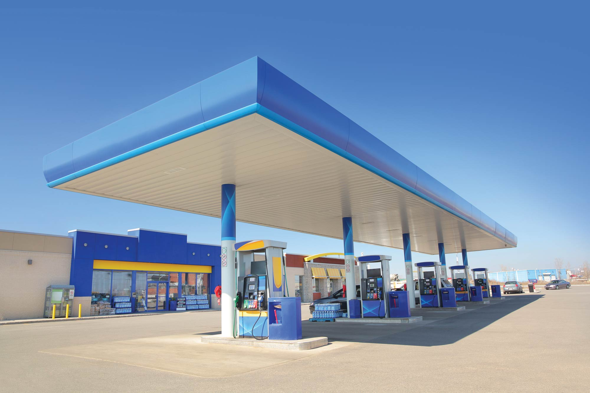 modern gas station and convenience store under a clear blue sky